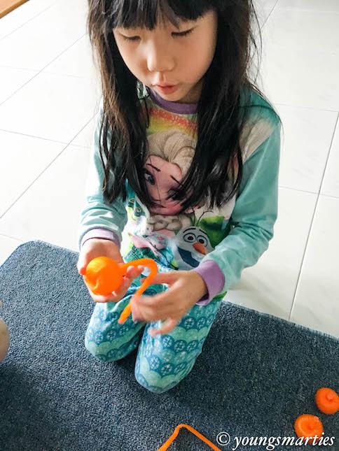 mei mei making oranges