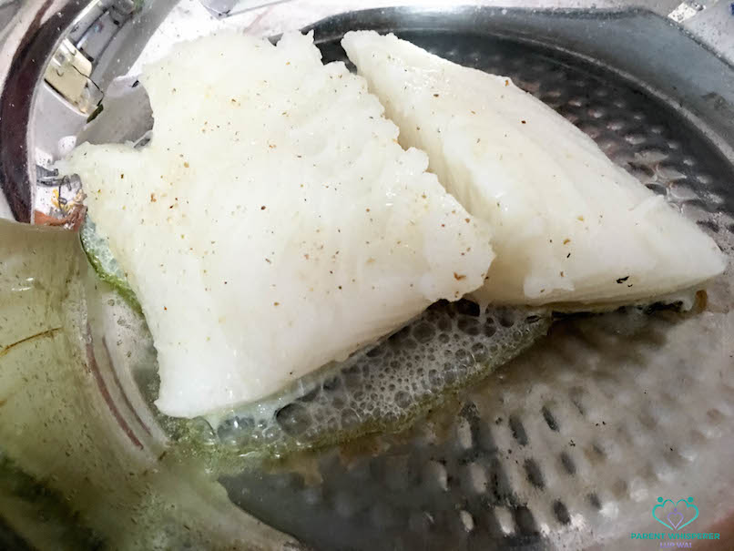 Pan fry cod fillet with skin down